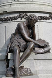 Boy reading monument detail Stock Photo