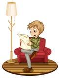 Boy reading newspaper Stock Photo