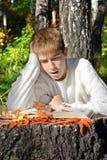 Boy reading outdoor Stock Photography