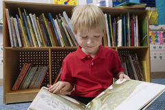 Boy Reading Picture Book Royalty Free Stock Images