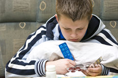 Boy reading pills labels Royalty Free Stock Images