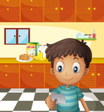 A boy reading a recipe Royalty Free Stock Image