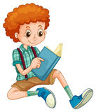 Boy reading. Boy with red curly hair reading a book Stock Images