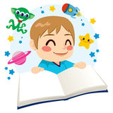 Boy Reading Science Fiction Book. Cute little boy happy reading a science fiction space exploration adventures book Stock Image