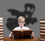 Boy reading spooky tales Royalty Free Stock Photo