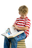 Boy reading story Royalty Free Stock Image