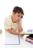 Boy reading studying textbooks Stock Images