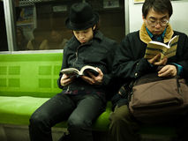Boy reading in subway Stock Photo