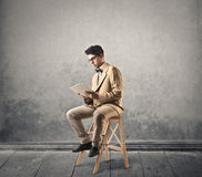 Boy reading from a tablet royalty free stock images