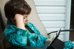 Boy reading on a tablet Royalty Free Stock Images