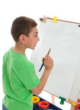Boy reading to paint Royalty Free Stock Photography