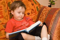 Boy reads book Royalty Free Stock Photography
