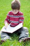 A boy reads a book Stock Photography