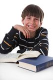Boy reads book. Little boy reads big book Stock Photo