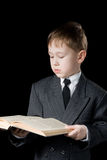 The boy reads the book. Stock Photography