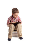 Boy reads book Stock Photography