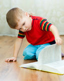 Boy reads a book Stock Images