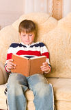 Boy reads book Royalty Free Stock Images