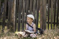 Boy reads a book Stock Photos