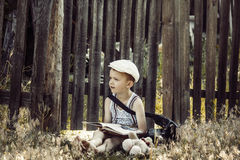 Boy reads a book Stock Image