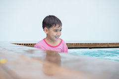 Boy ready in the corner to swim out. Little boy playing water at swimming pool inthe hotel Royalty Free Stock Photo