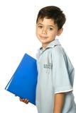 Boy ready for school holding a blue folder. stock photos