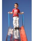 Boy ready for slide. Children Stock Images