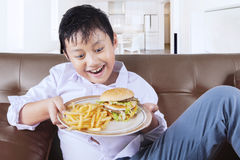Boy ready to eat junk food at home Royalty Free Stock Images