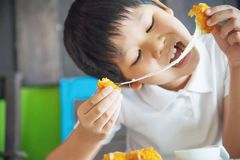 Boy ready to eat sticky stretch fried cheese ball stock images