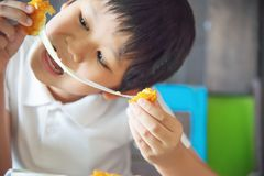 Boy ready to eat sticky stretch fried cheese ball royalty free stock photography