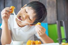Boy ready to eat sticky stretch fried cheese ball royalty free stock photo