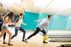 Boy Ready To Go Bowling With Some Friends At Alley. Full length of teenage boy ready to go bowling with some friends at alley in club royalty free stock photo