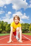 Boy in ready to run with both arms on ground Royalty Free Stock Images