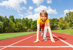 Boy ready to run on road looking straight Royalty Free Stock Photo