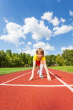 Boy ready to run with two straight arms on ground Royalty Free Stock Photos