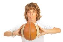 Boy ready to throw basketball Stock Photos
