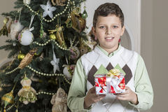 Boy receives Christmas gift Royalty Free Stock Photo