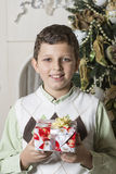 Boy receives Christmas gift Royalty Free Stock Images