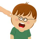 Boy receives physical punishment from the adult. Have grabbed by an ear Stock Images