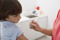 Boy Receiving Injection Stock Image