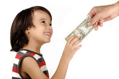 Boy receiving money. From adult Royalty Free Stock Photos