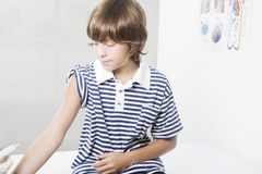 Boy receiving vaccination. At medical doctor office Royalty Free Stock Images