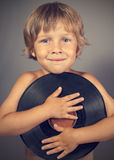 Boy with a record smiles Stock Photography