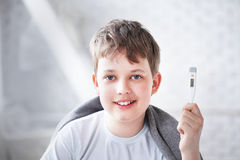 Boy recovered thermometer shows Stock Image