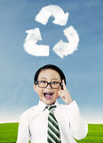 Boy with recycle symbol Stock Photo