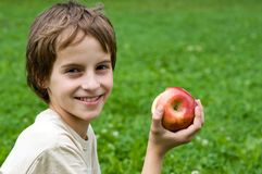 Boy with red apple Royalty Free Stock Images