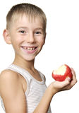 Boy with red apple Stock Photos