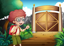A boy with a red backpack inside the gated yard Royalty Free Stock Image