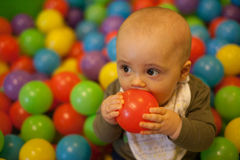 Boy with red ball Stock Images