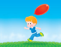 Boy with a red balloon. Boy running with a red balloon through a field Royalty Free Stock Images